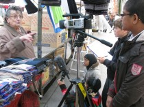 interviewing a trader on Leather Lane market